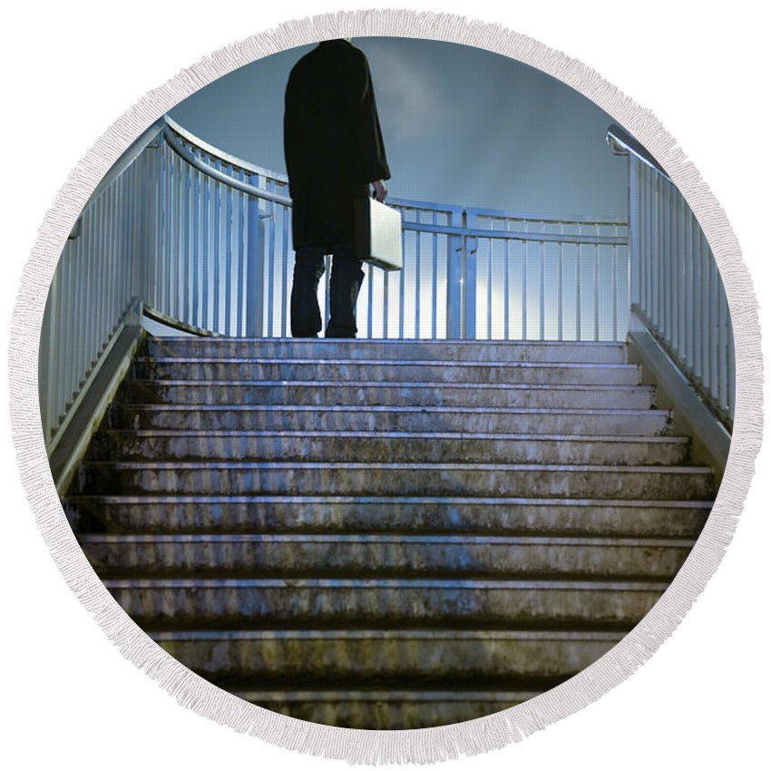 Man Round Beach Towel featuring the photograph Man With Case At Night On Stairs by Lee Avison
