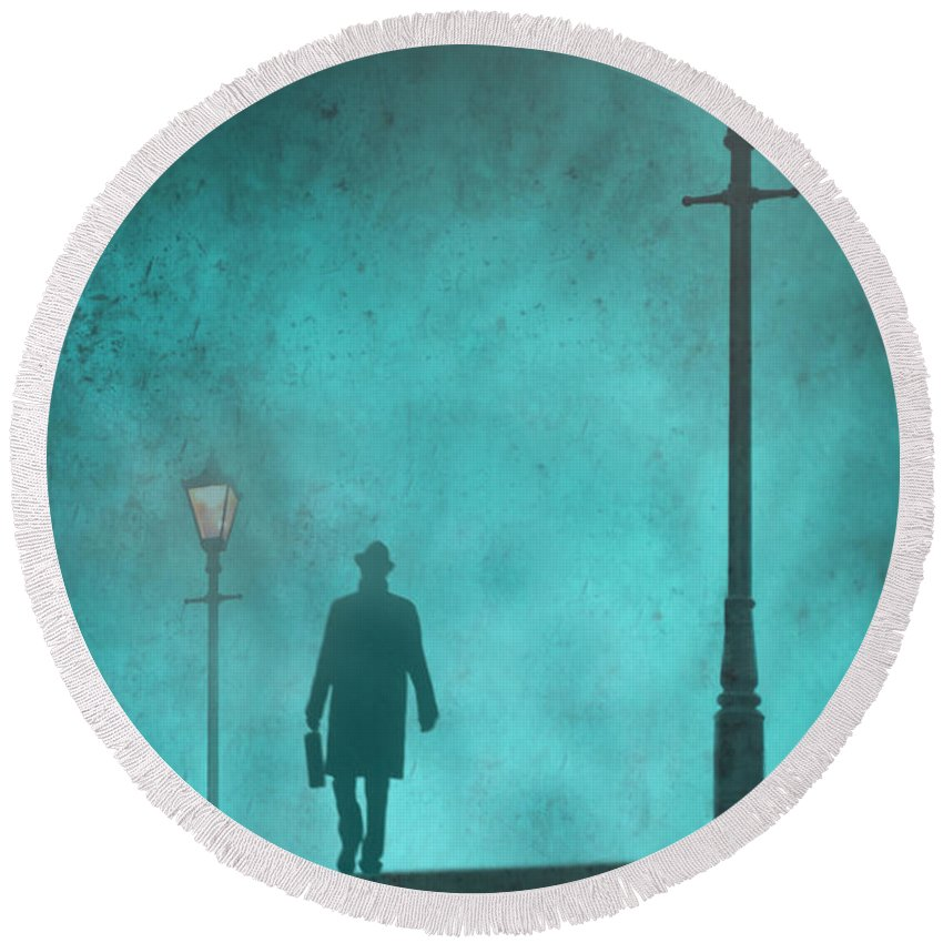 Spy Round Beach Towel featuring the photograph Man With Hat And Overcoat Carrying A Briefcase In Fog by Lee Avison