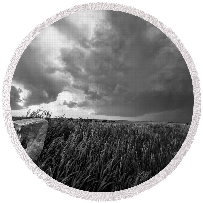 Black And White Round Beach Towel featuring the photograph Marker - Black And White Photo Of Stone Marker And Brewing Storm In Kansas by Sean Ramsey
