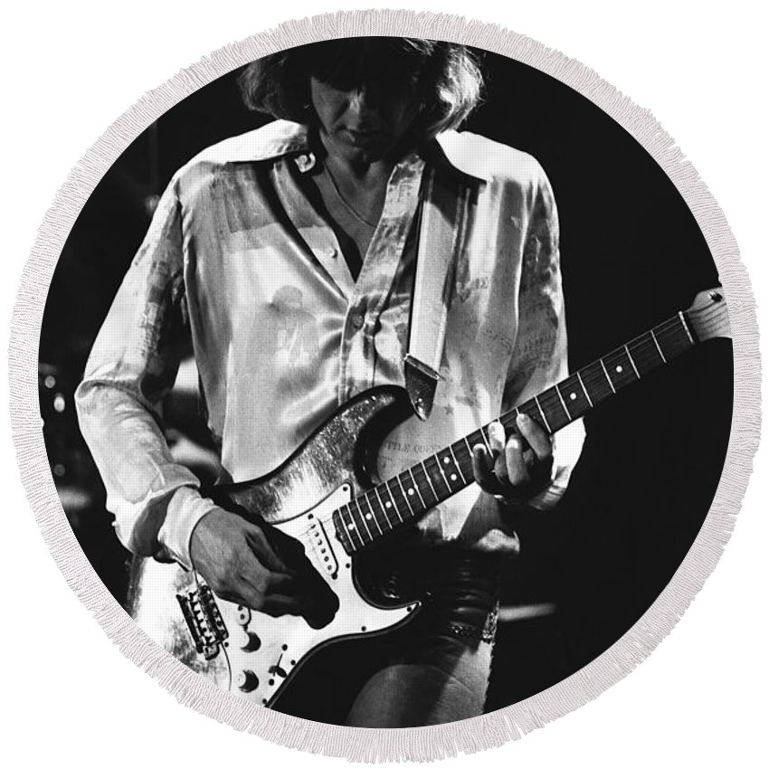 Mick Ralphs Round Beach Towel featuring the photograph Mick On Guitar 1977 by Ben Upham