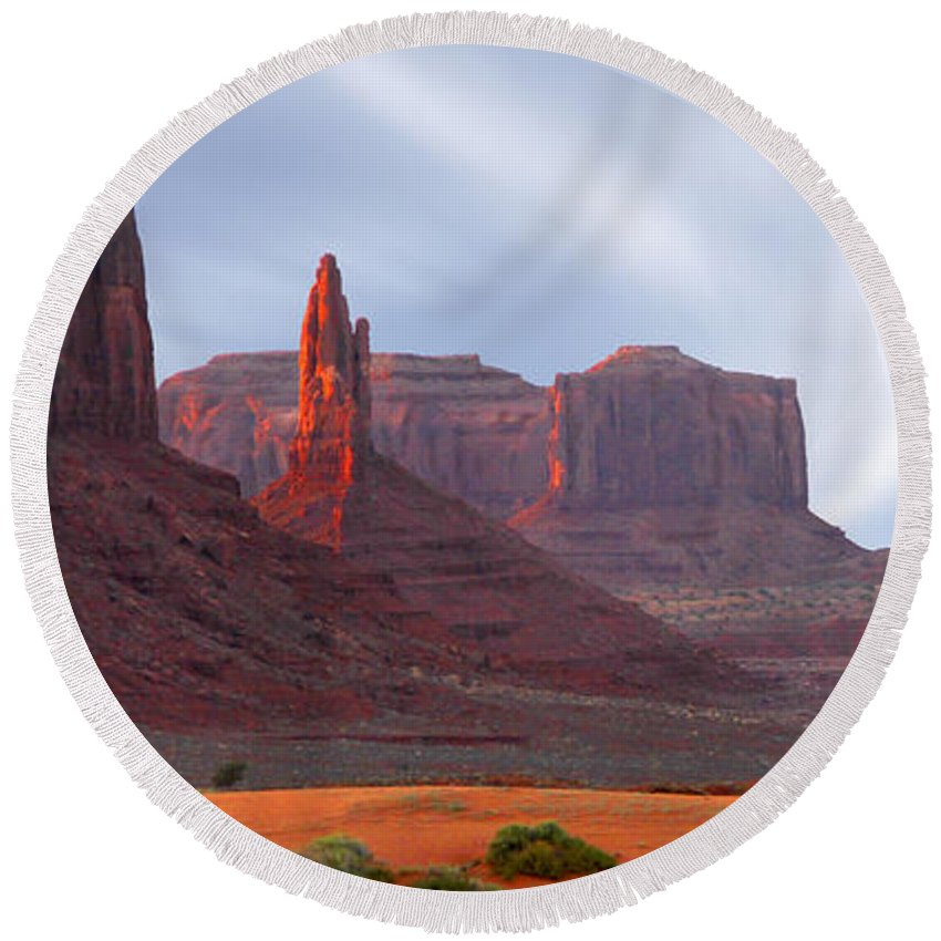 Desert Round Beach Towel featuring the photograph Monument Valley At Sunset Panoramic by Mike McGlothlen