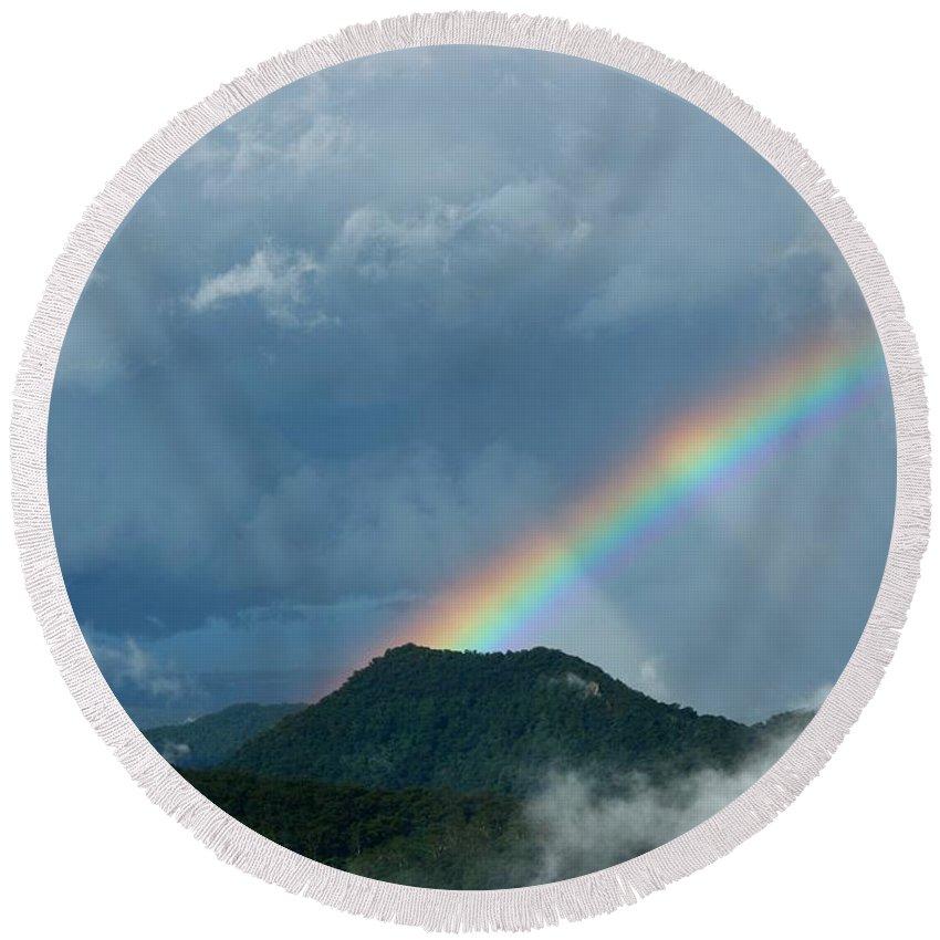 Spectrum Round Beach Towel featuring the photograph Mystic Rainbow by Darren Burton