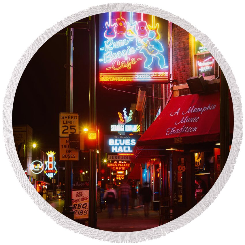 Photography Round Beach Towel featuring the photograph Neon Sign Lit Up At Night In A City by Panoramic Images