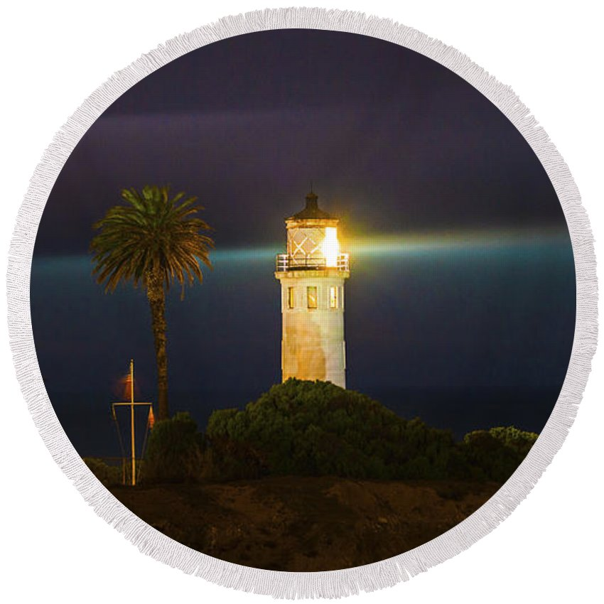 Lighthouse Round Beach Towel featuring the photograph Night Lighthouse On The Bluff by Jerry Cowart