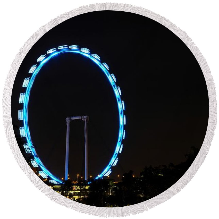 Singapore Flyer Round Beach Towel featuring the photograph Night Shot Of The Singapore Flyer Ferris Wheel At Marina Bay by Imran Ahmed