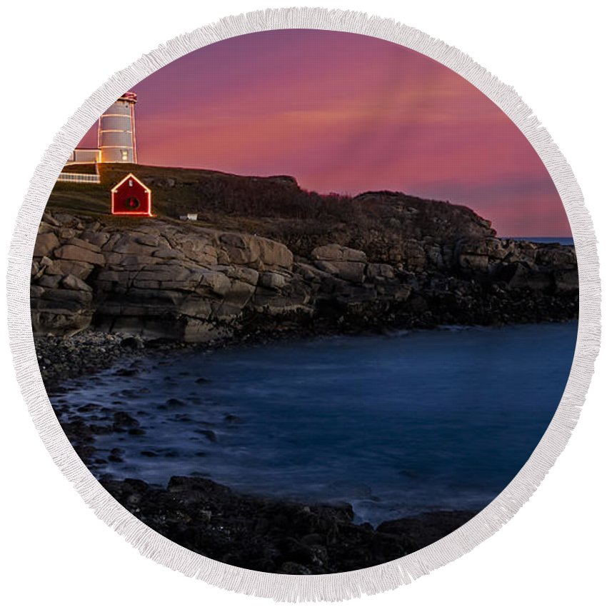 Nubble Lighthouse Round Beach Towel featuring the photograph Nubble Lighthouse At Sunset by Susan Candelario