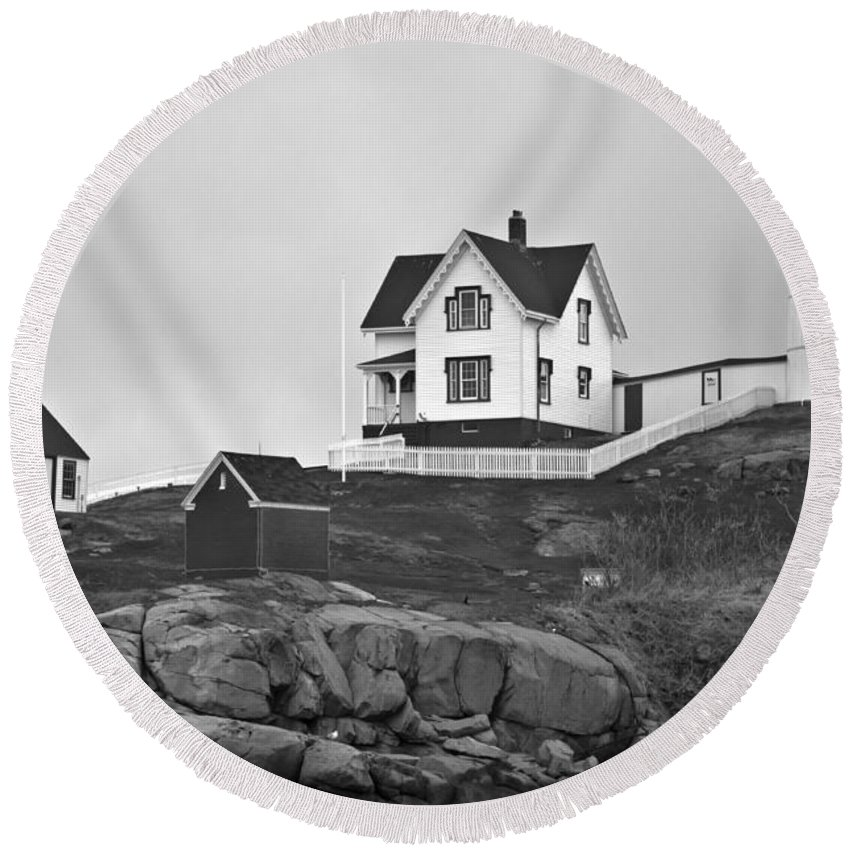Nubble Lighthouse Round Beach Towel featuring the photograph Nubble Lighthouse Cape Neddick Maine Black And White by Glenn Gordon
