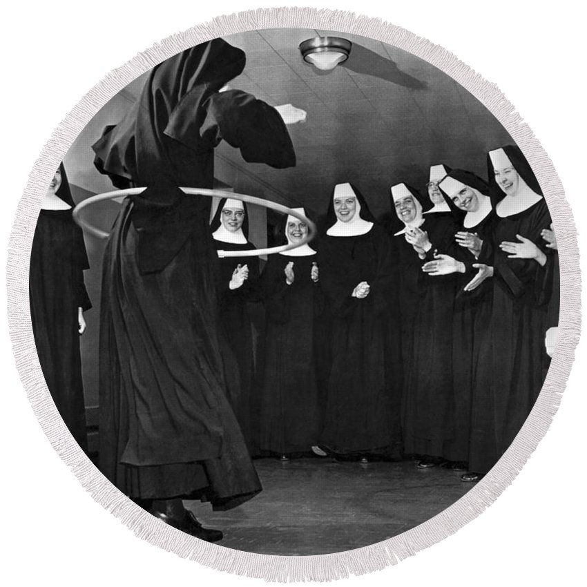 1958 Round Beach Towel featuring the photograph Nun Swivels Hula Hoop On Hips by Underwood Archives