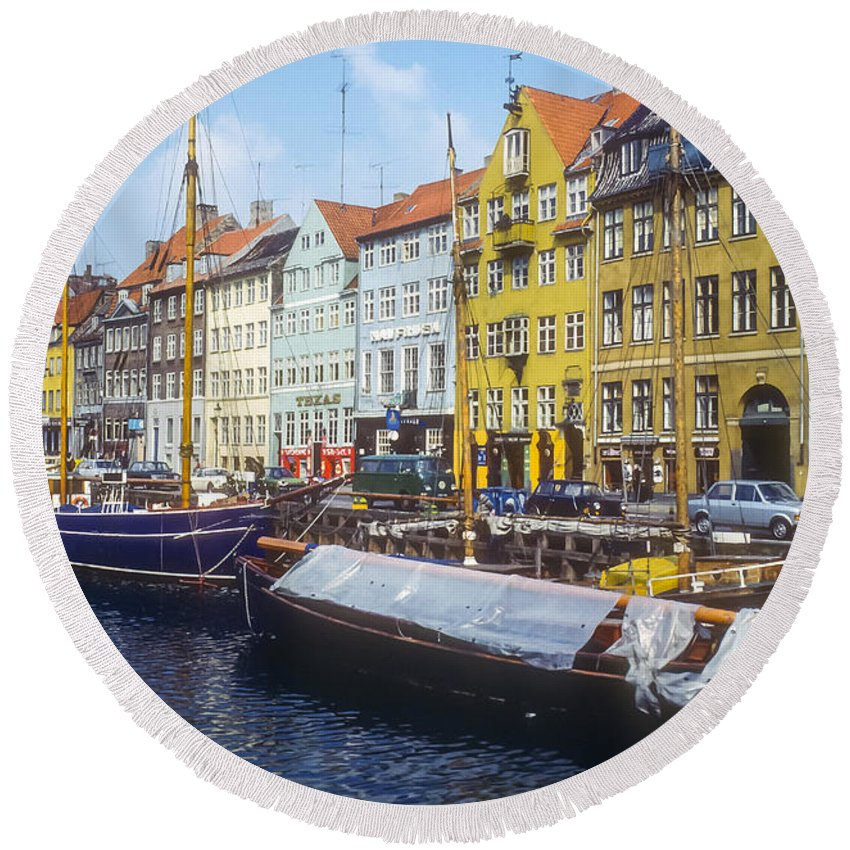Nyhavn Canal Copenhagen Denmark Boat Dock Docks Boats Canals House Houses Building Buildings Structures Architecture Store Stores Shop Shops City Cities Cityscape Cityscapes Round Beach Towel featuring the photograph Nyhavn Boat Docks by Bob Phillips