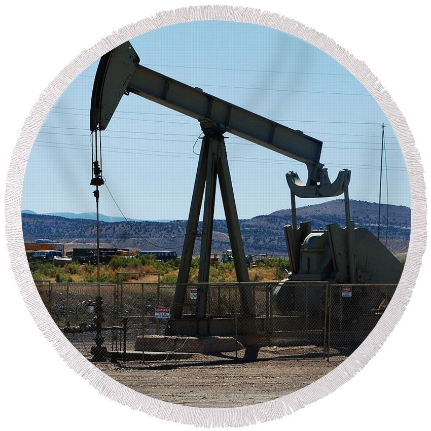 Oil Well Round Beach Towel featuring the photograph Oil Well Pumper by Dany Lison