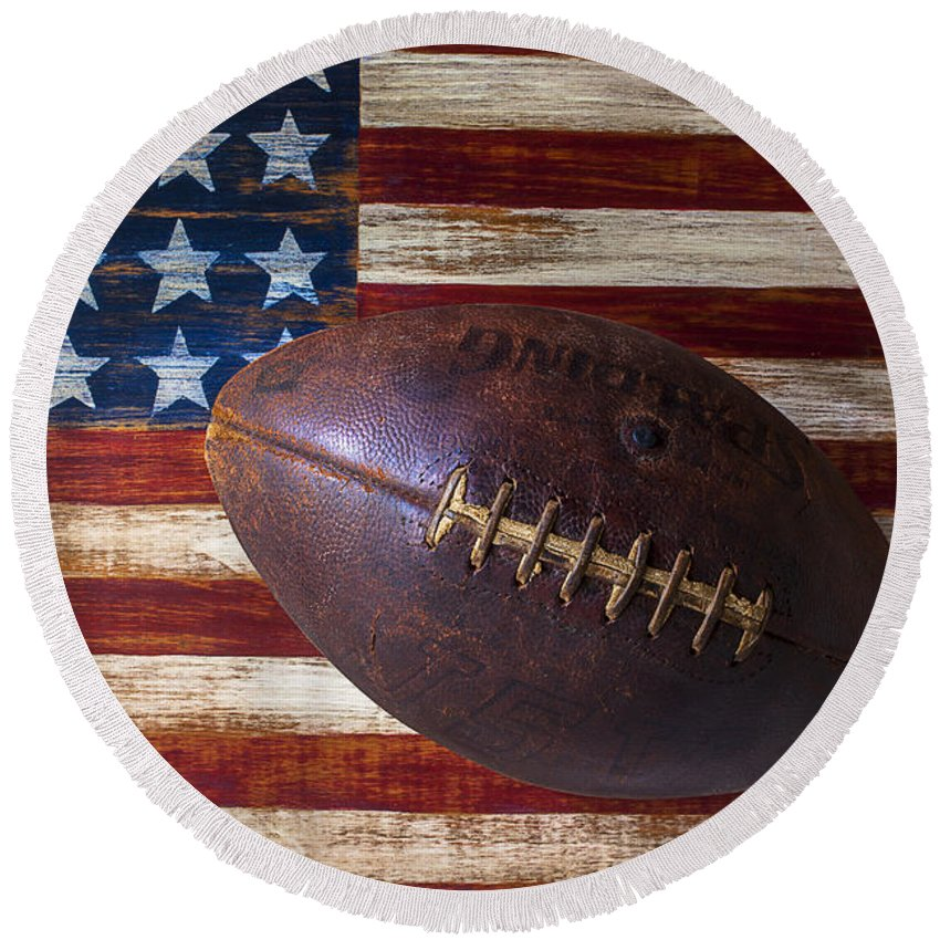 Football Round Beach Towel featuring the photograph Old Football On American Flag by Garry Gay