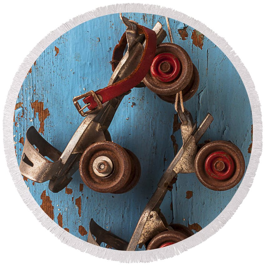 Old Roller Skates Round Beach Towel featuring the photograph Old Roller Skates by Garry Gay