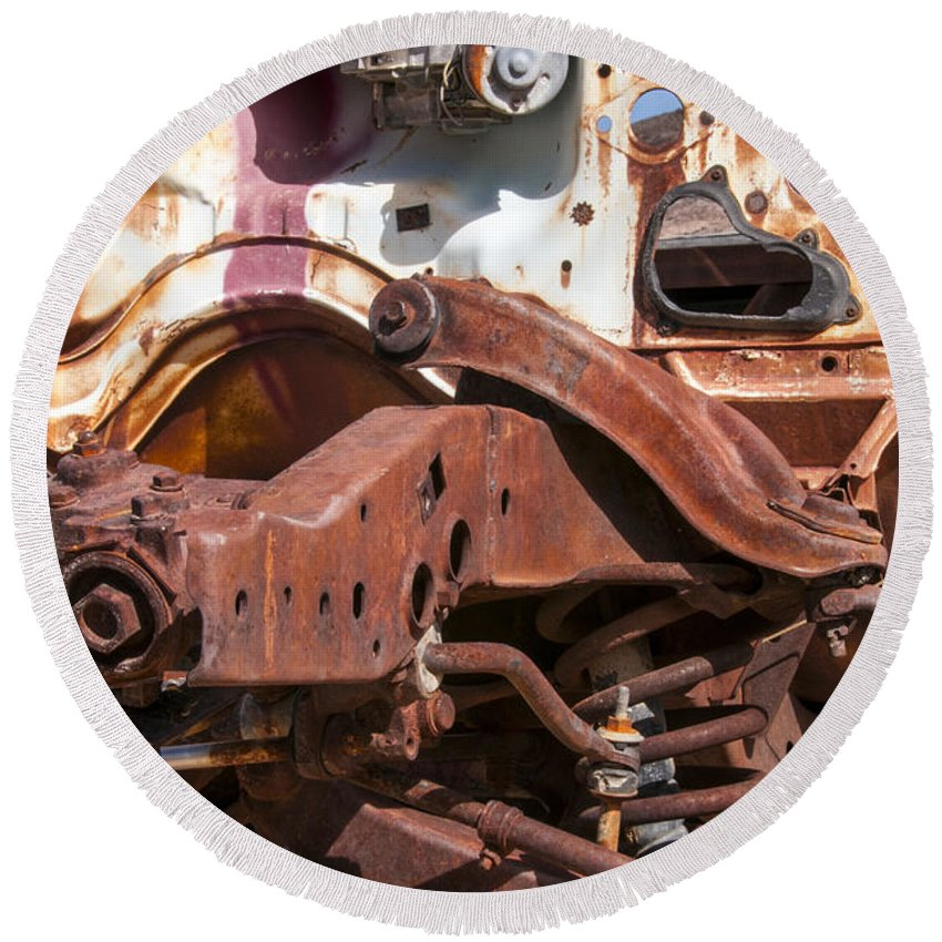 Rhyolite Nevada Ghost Town Nevada Car Cars Rusted Rusty Spring Springs Frame Frames Historic Townsite Auto Parts Automobile Automobiles Odds And Ends Round Beach Towel featuring the photograph Old Rusty by Bob Phillips