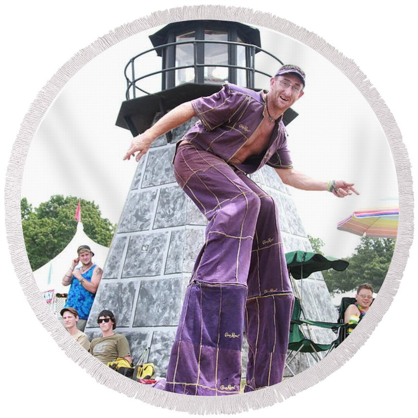 Stilts Round Beach Towel featuring the photograph One Tall Dude by Concert Photos