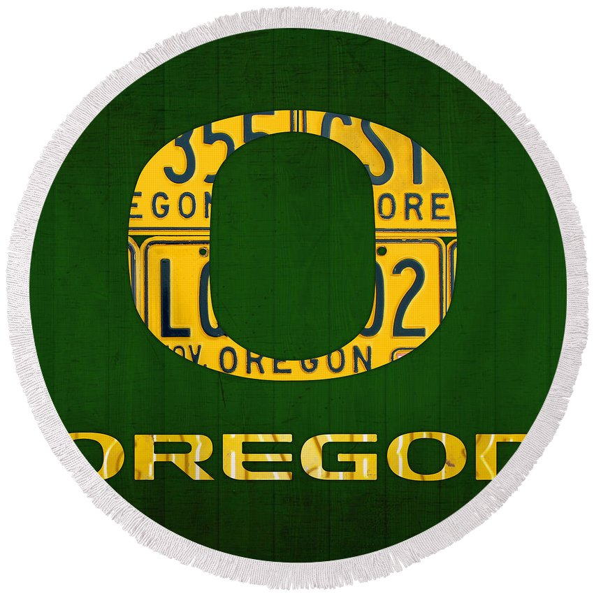 Oregon Round Beach Towel featuring the mixed media Oregon Ducks Vintage Recycled License Plate Art by Design Turnpike