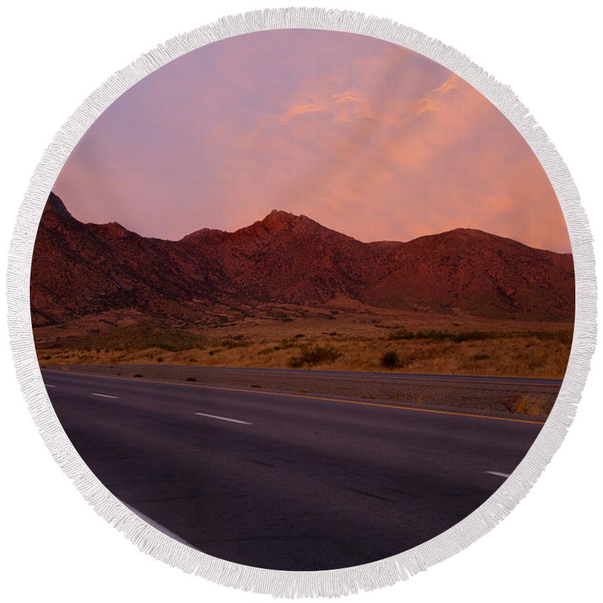 New Mexico Round Beach Towel featuring the photograph Organ Mountain Sunrise Highway by Mike Dawson