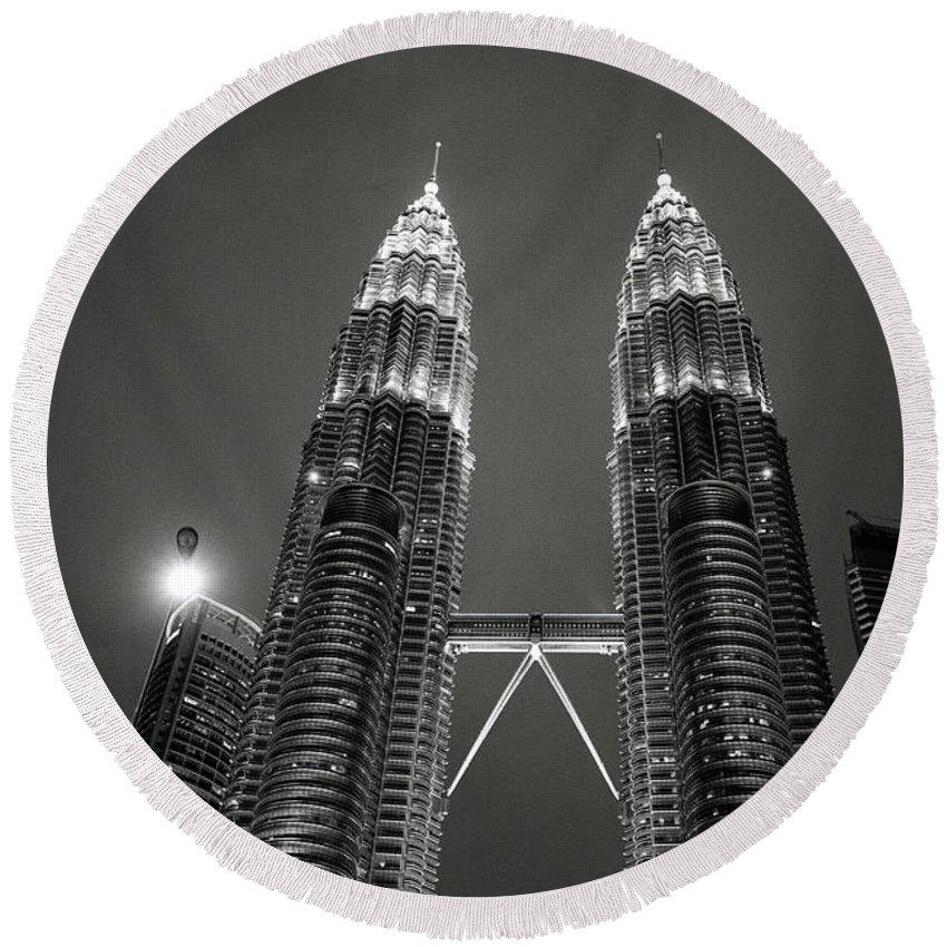 Petronas Towers Round Beach Towel featuring the photograph Petronas Towers At Night by Shaun Higson