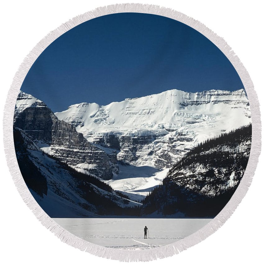 Alberta Round Beach Towel featuring the photograph Photog On Lake Louise by Roderick Bley