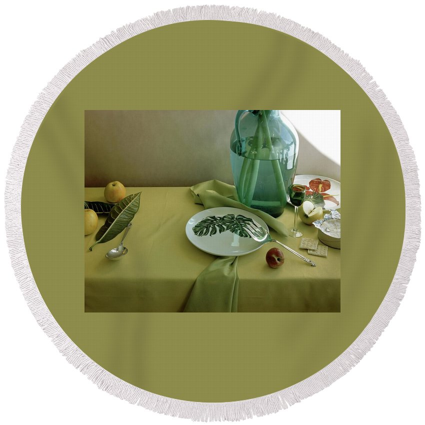 Table Setting Round Beach Towel featuring the photograph Plates, Apples And A Vase On A Green Tablecloth by Horst P. Horst