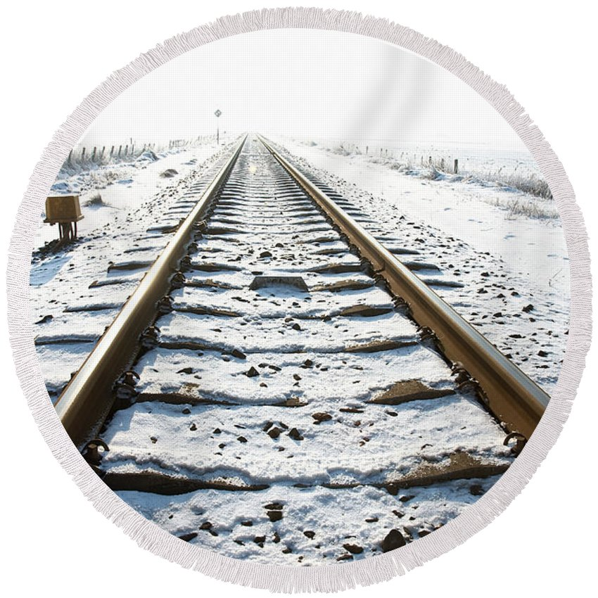Ice Round Beach Towel featuring the photograph Railroad In Snow by Jan Brons