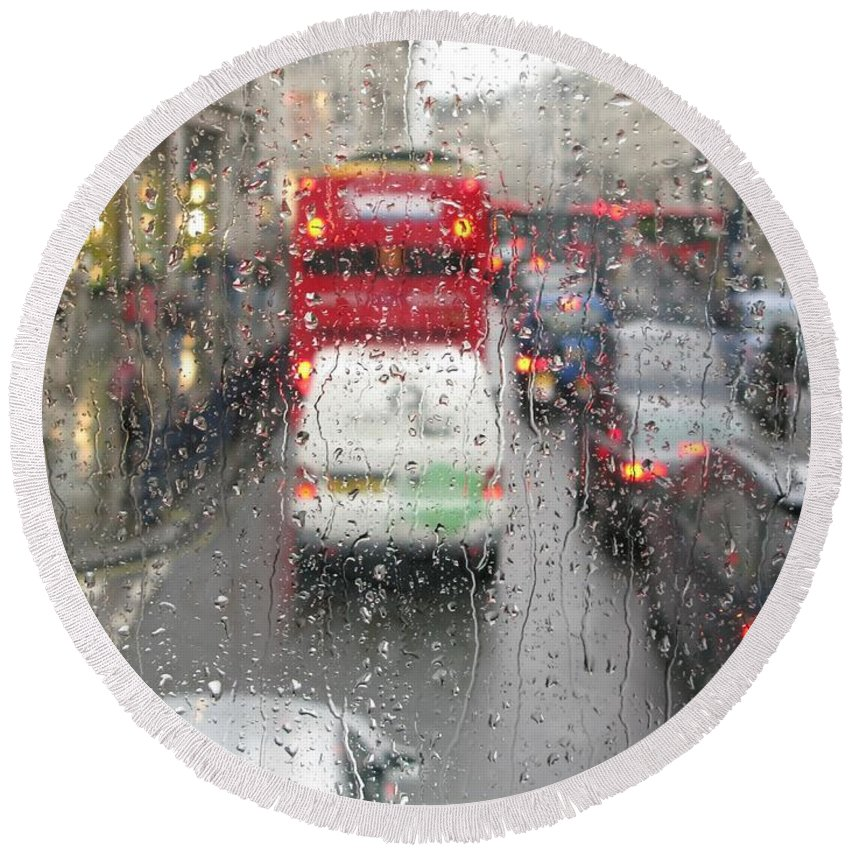 Rainy Day London Traffic By Ann Horn Round Beach Towel featuring the photograph Rainy Day London Traffic by Ann Horn