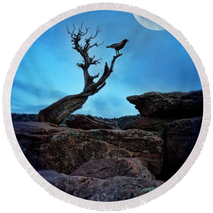 Raven Round Beach Towel featuring the photograph Raven On Twisted Tree With Moon by Jill Battaglia