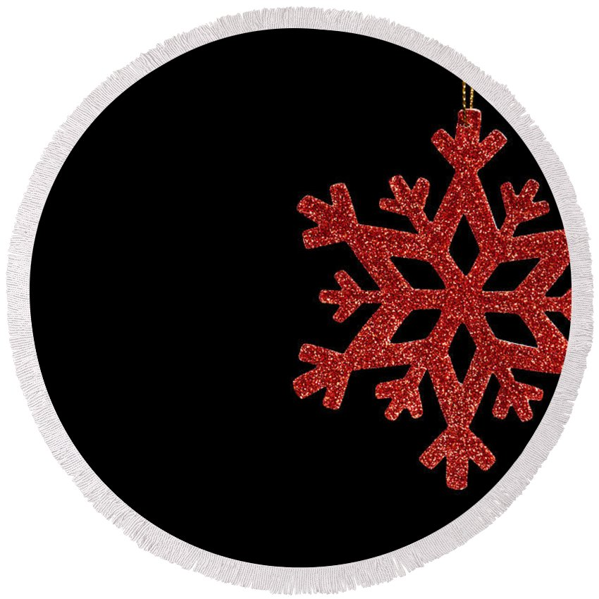 Abstract Round Beach Towel featuring the photograph Red Snow Flake On A Black Background by U Schade