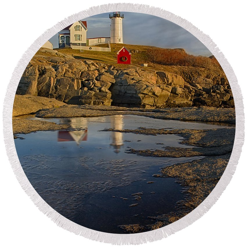 Nubble Lighthouse Round Beach Towel featuring the photograph Reflecting On Nubble Lighthouse by Susan Candelario