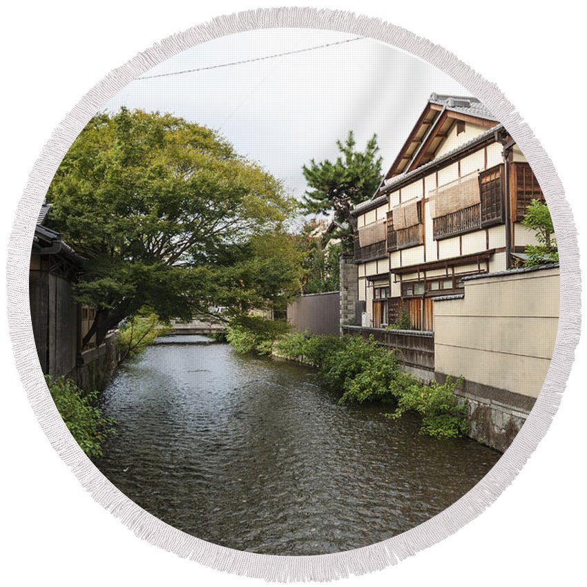 Architecture Round Beach Towel featuring the photograph River And Houses In Kyoto Japan by Jacek Malipan