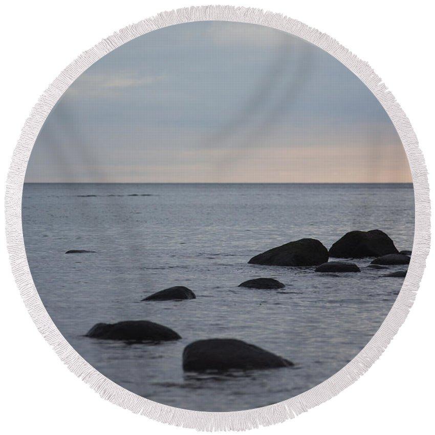 Island Of Ruegen Round Beach Towel featuring the photograph Rocks In Water by Ralf Kaiser