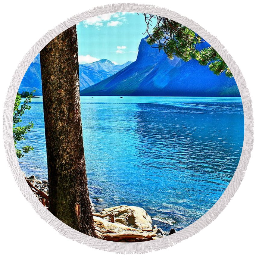 Lake Round Beach Towel featuring the photograph Rooted In Lake Minnewanka by Linda Bianic