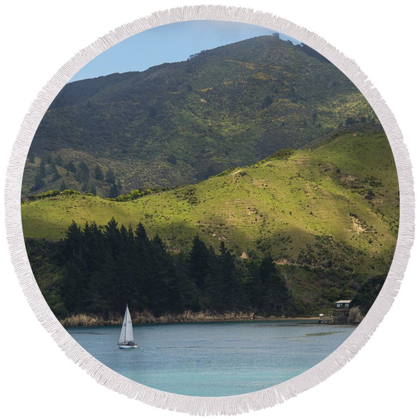 Cook Strait New Zealand Water Grass Grasses Tree Trees Rock Rocks Hill Hillside Hills Hillsides Landscape Landscapes Waterscape Waterscapes Sailboat Sailboats Boat Boats Round Beach Towel featuring the photograph Sailing Cook Strait by Bob Phillips