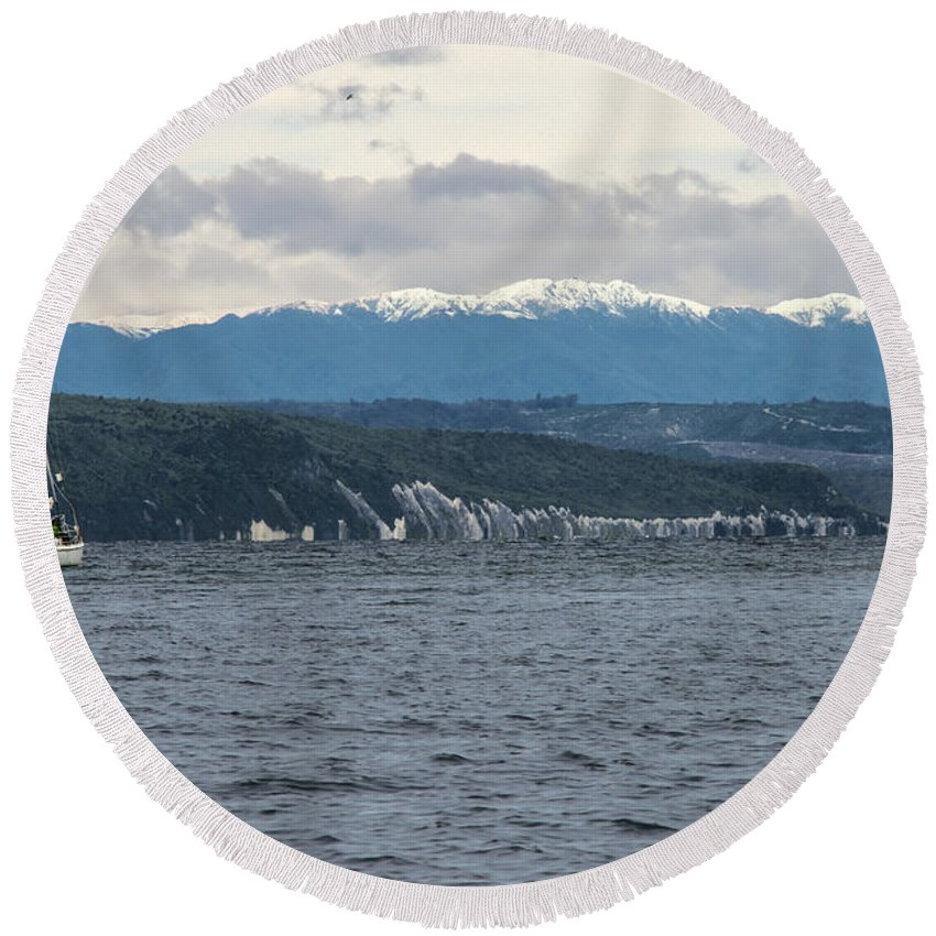 Lake Taupo New Zealand Water Hill Hillside Hills Hillsides Mountain Mountains Snow Landscape Landscapes Waterscape Waterscapes Sailboat Sailboats Boat Boats Round Beach Towel featuring the photograph Sailing Lake Taupo by Bob Phillips
