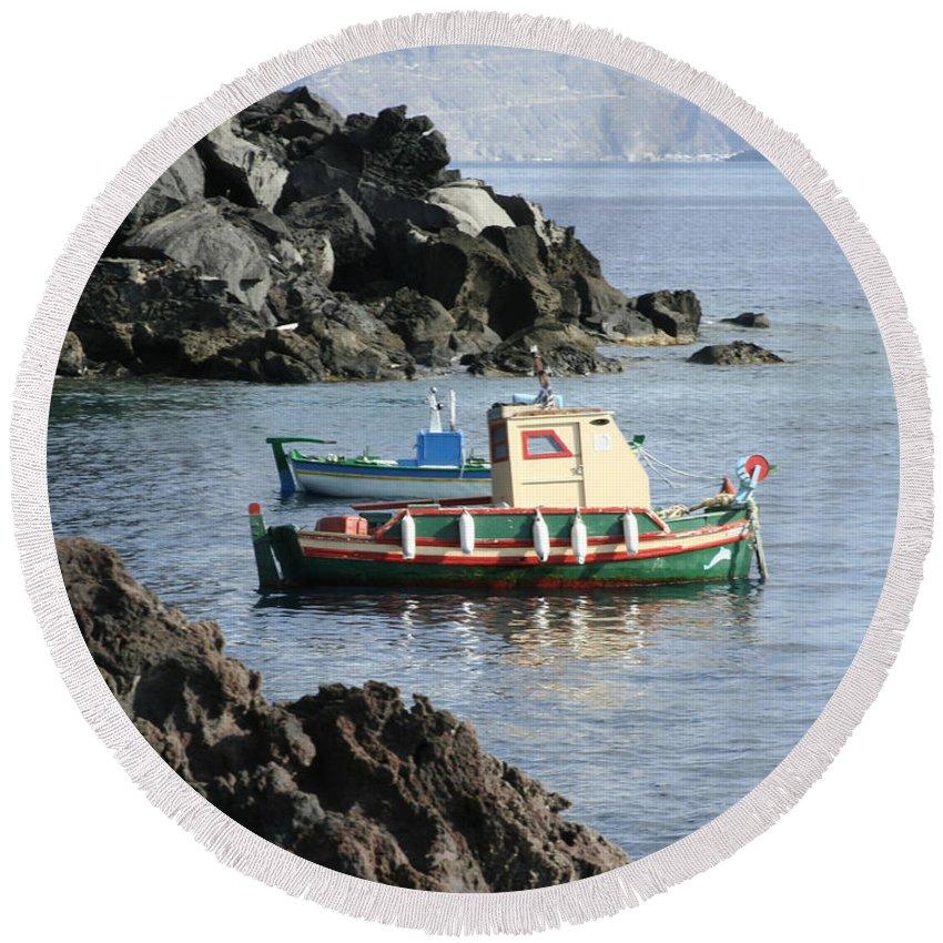 Santorini Fishing Boats Rocks Caldera Greek Islands Aegean Sea Seascape Round Beach Towel featuring the photograph Santorini Boats by Brenda Salamone