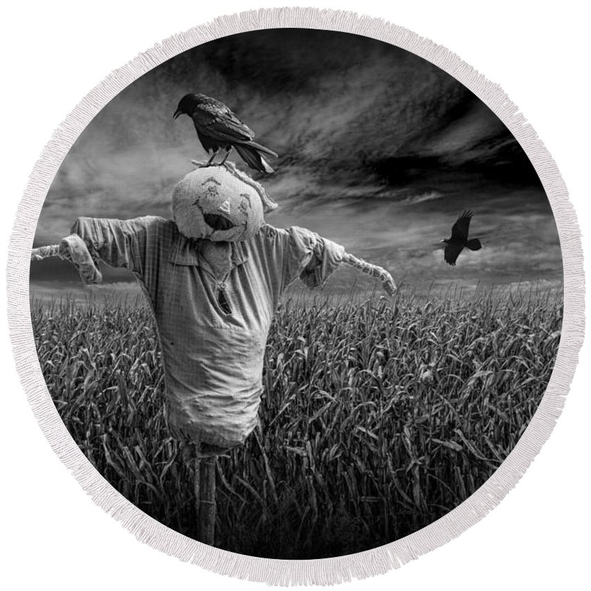 Scarecrow Round Beach Towel featuring the photograph Scarecrow And Black Crows Over A Cornfield by Randall Nyhof