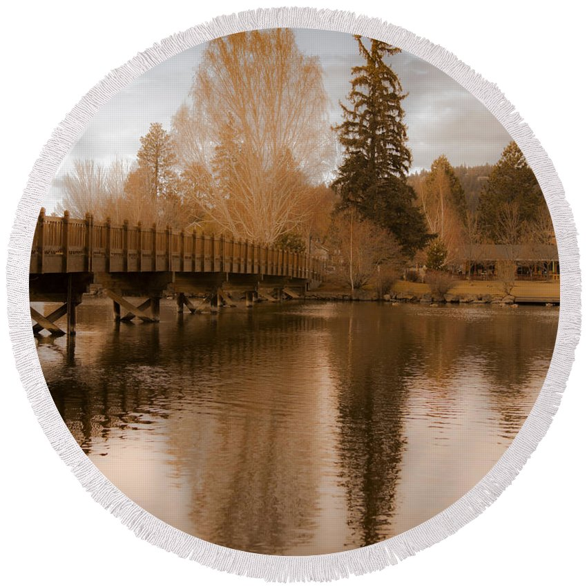 Spring Scenic Golden Wooden Bridge Photographs Photography Round Beach Towel featuring the photograph Scenic Golden Wooden Bridge Tree Reflection On The Deschutes River by Jerry Cowart