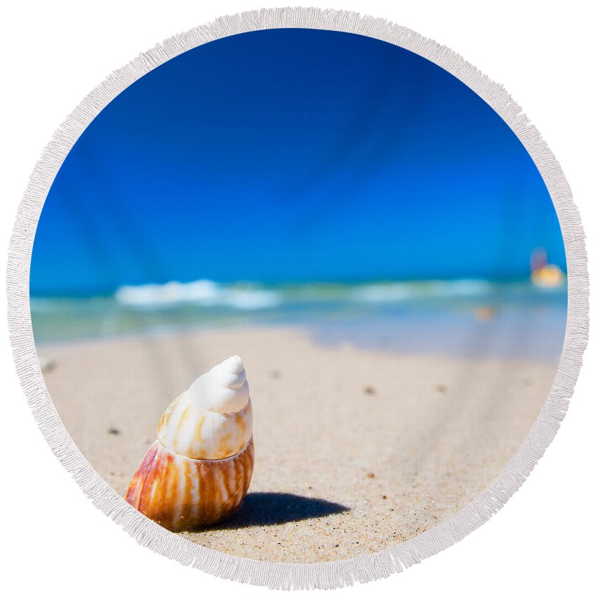 Background Round Beach Towel featuring the photograph Sea Shell On The Beach by Michal Bednarek