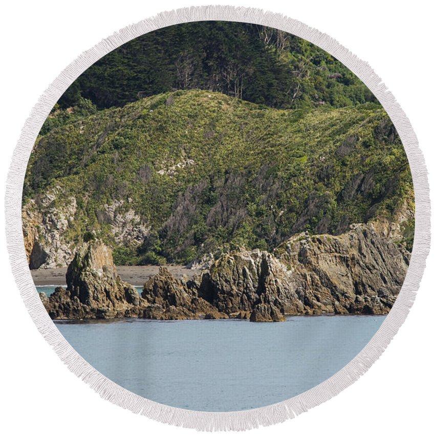 Cook Strait New Zealand Water Tree Trees Rock Rocks Hill Hillside Hills Hillsides Landscape Landscapes Waterscape Waterscapes Round Beach Towel featuring the photograph Seaside Rocks by Bob Phillips