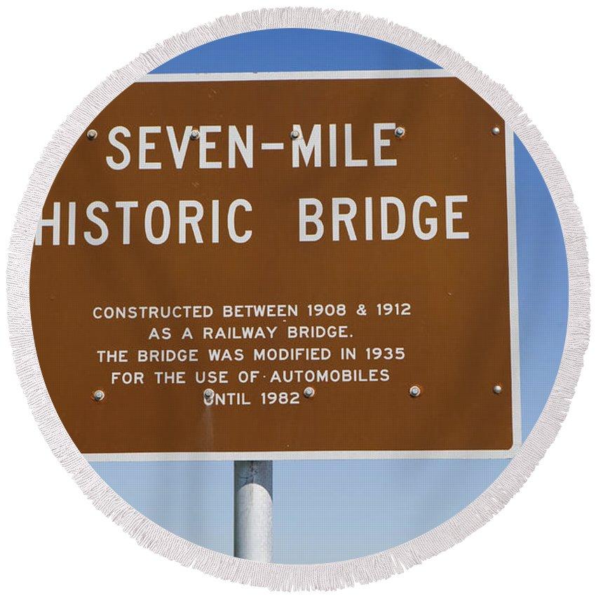 Seven-mile Historic Bridge Round Beach Towel featuring the photograph Seven Mile Bridge Florida Keys Sign by Jason O Watson