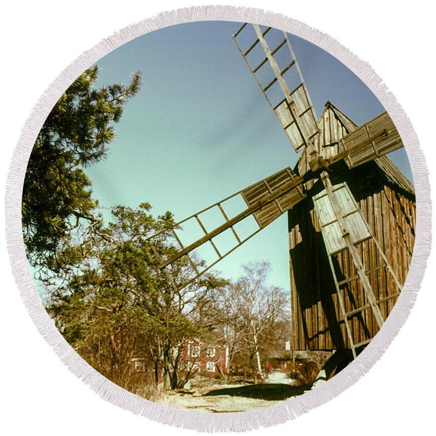 Skansen Outdoor Museum Stockholm Sweden Windmill Windmills Mill Mills Structure Structures Architecture Round Beach Towel featuring the photograph Skansen Outdoor Museum by Bob Phillips