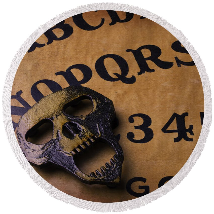 Darkness Round Beach Towel featuring the photograph Skull Planchette by Garry Gay