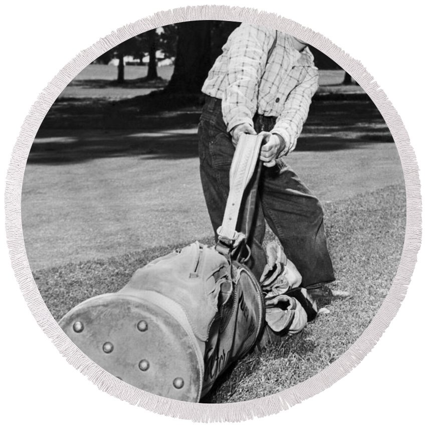 1940s Round Beach Towel featuring the photograph Small Boy Totes Heavy Golf Bag by Underwood Archives