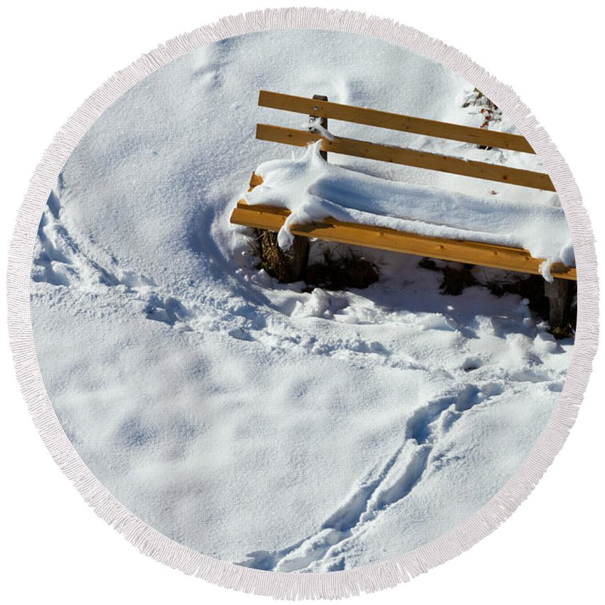 Background Round Beach Towel featuring the photograph Snowy Foot Prints Around Snow Covered Park Bench by Stephan Pietzko