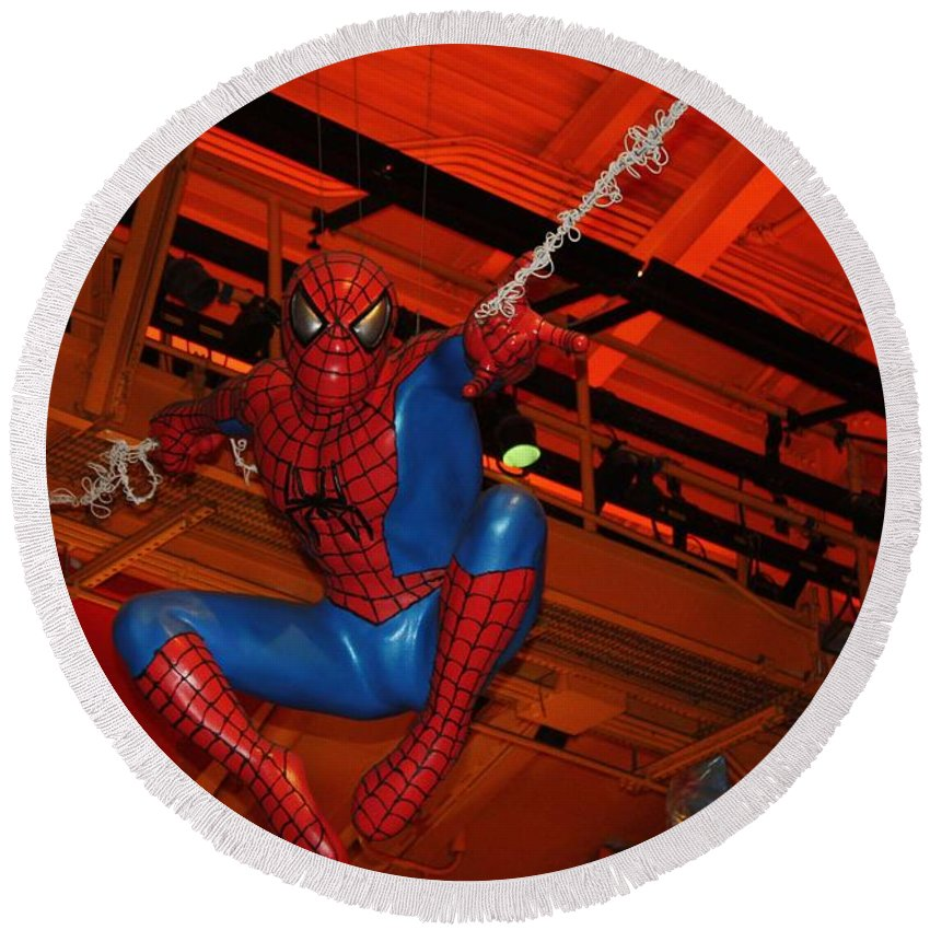 Spiderman Swinging Through The Air Round Beach Towel featuring the photograph Spiderman Swinging Through The Air by John Telfer