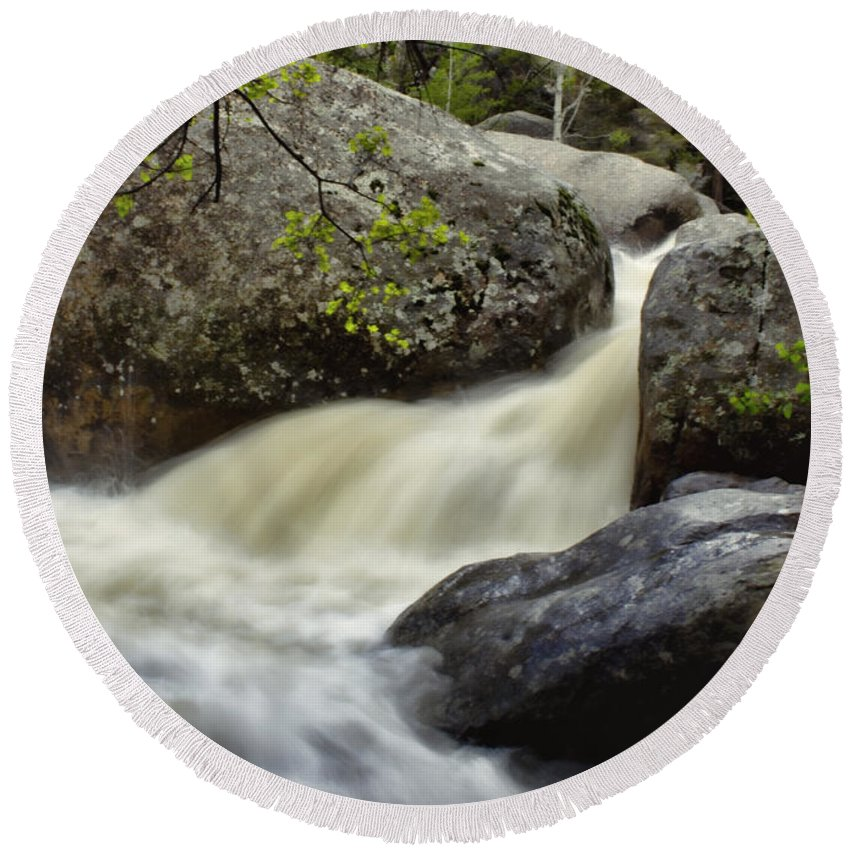 Rocky Mountains Round Beach Towel featuring the photograph Spring Runoff by Ellen Heaverlo