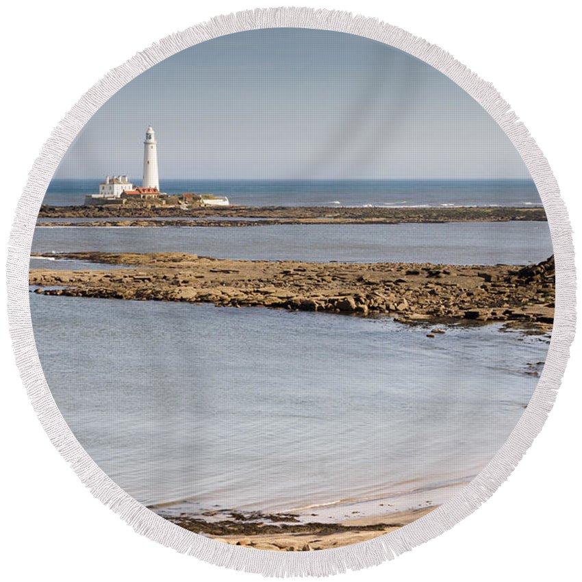 St Marys Lighthouse Round Beach Towel featuring the photograph St Marys Lighthouse Across Sandy Bay by David Head