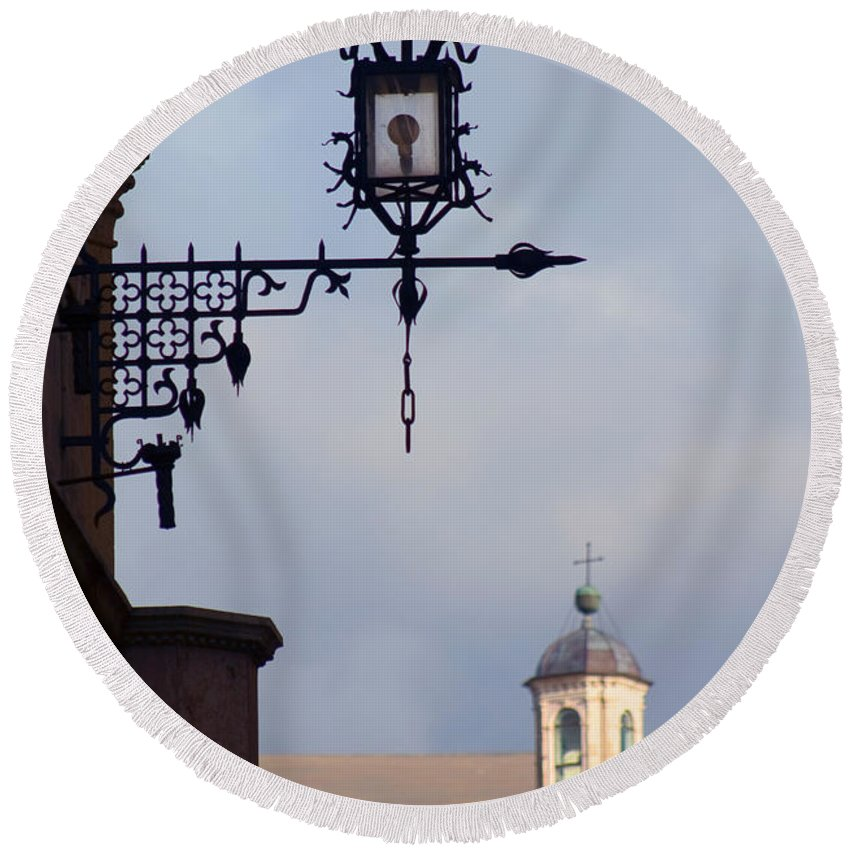 Wrought Iron Round Beach Towel featuring the photograph Street Lamp, Assisi by Tim Holt