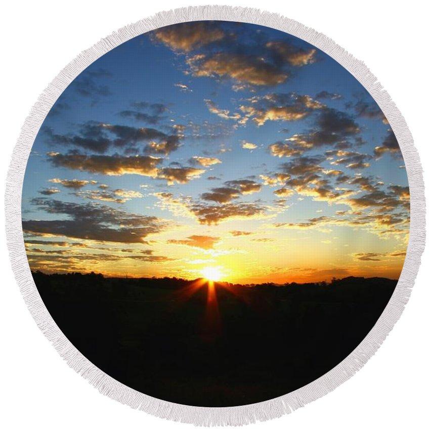 Sun Round Beach Towel featuring the photograph Sun Setting Behind The Mountains by Darren Burton
