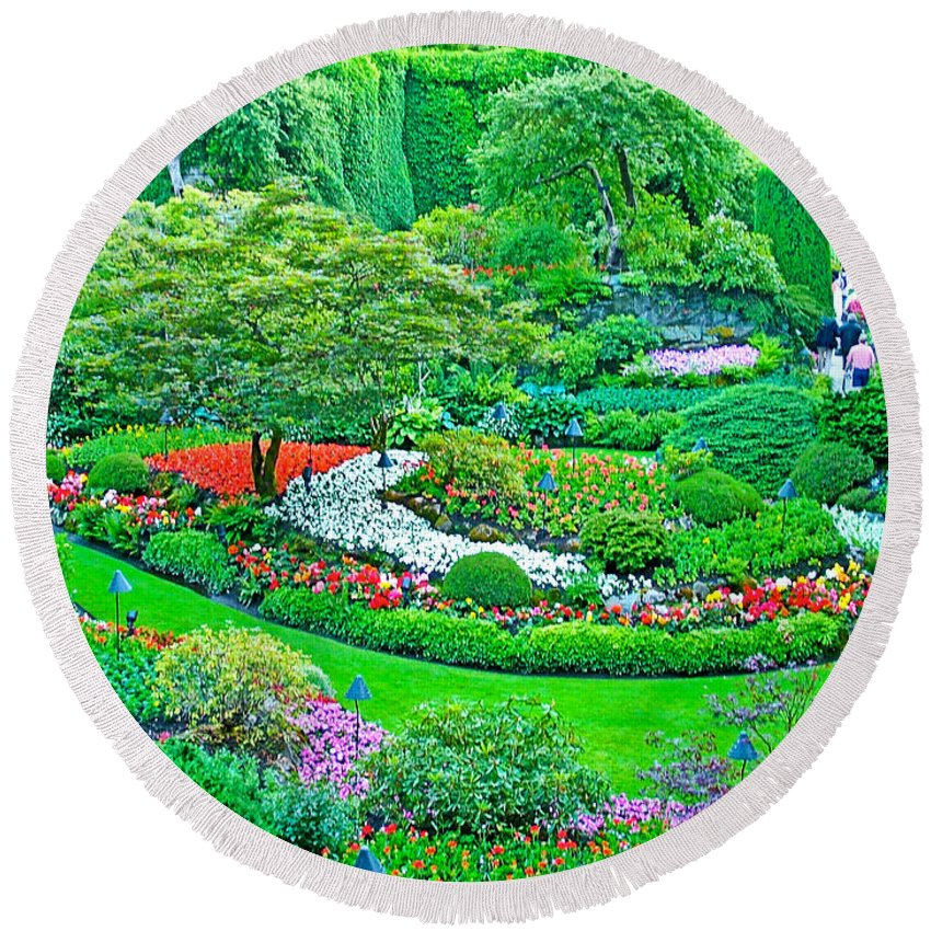Sunken Garden In Butchart Gardens Near Victoria Round Beach Towel featuring the photograph Sunken Garden In Butchart Gardens Near Victoria-british Columbia by Ruth Hager