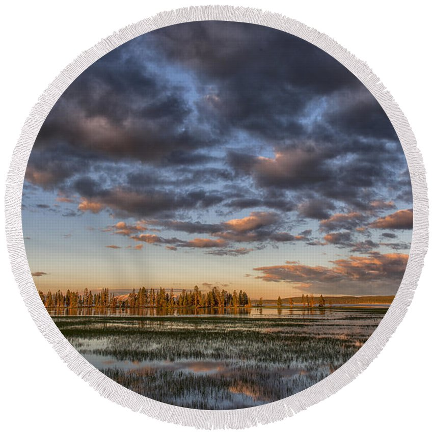 Sunrise;yellowstone;lake;waterscape;national;park;clouds;morning;dawn;reflections;reflection;island;trees;iconic;travel;tourism;popular; Round Beach Towel featuring the photograph Sunrise On Yellowstone Lake by Sandra Bronstein